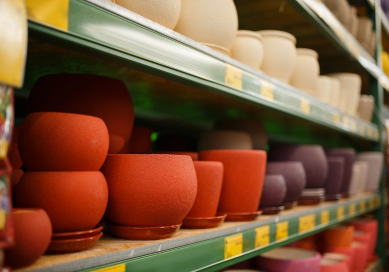 Flower pots assortment on the shelf, shop for floristry, nobody. Equipment variation in store for floriculture, florist instrument choice